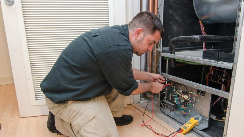 What are the reasons behind the heat pump tripping the circuit breaker?